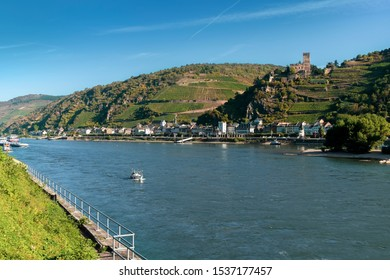 View of Gutenfels castle on the bank of the Rhine river and the town of Kaub on a beautiful autumn day.