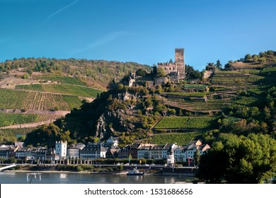 View of Gutenfels medieval castle and the town Kaub in the famous Rhine Gorge north of Rudesheim, Germany, on a sunny autumn morning.