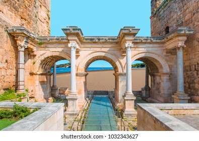 View of Hadrian's Gate in old city of Antalya with Sarigerme beach - Turkey