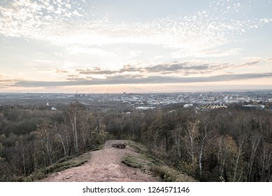 view from Hala Ema hill above Ostrava city in Czech republic during autumn twilight with blue sky and nice small clouds