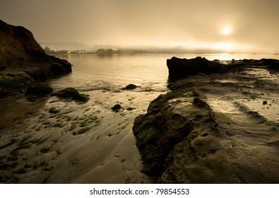 View of Half Moon Bay at dawn, with sailboats
