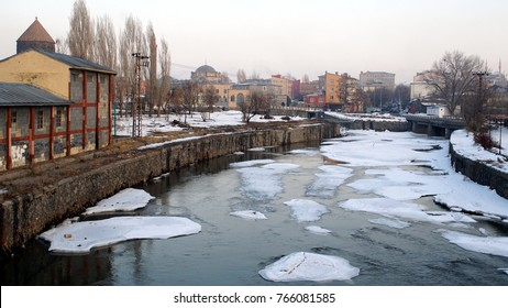 A view of half-frozen Kars Brook which is passing from the edge of the city Kars, Turkey. All lakes and streams in this city are frozen at winter months.