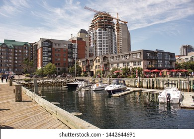 View from Halifax Harbour, Nova Scotia, Canada,  24th August 2017, showing boats, harbour buildings, a crane and construction work in progress. Halifax is the capital of the province of Nova Scotia.