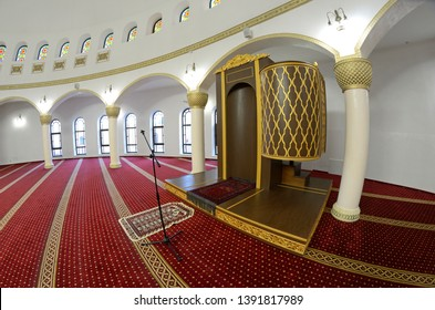 View of hall for praying (iwan) of the Ar-Rahma Mosque (Mercy Mosque) with minbar (pulpit).
