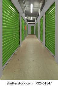 View of a hallway with several indoor storage units