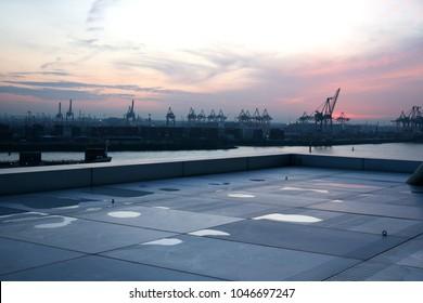 view of the hamburg industrial harbor at sunset after the rain, Hamburg, Germany
