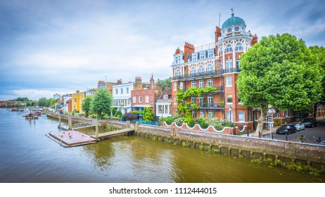 View from Hammersmith Bridge of attractive properties overlooking the river Thames on the Thames path
