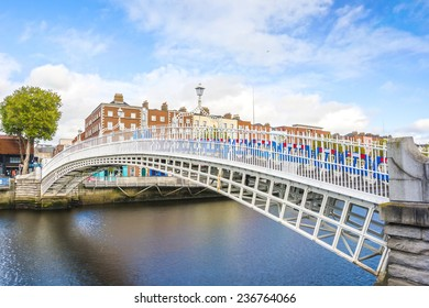 View of Hapenny Bridge over Liffey river in Dublin, Ireland