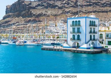 View of the harbor of Puerto de Mogan from the ocean