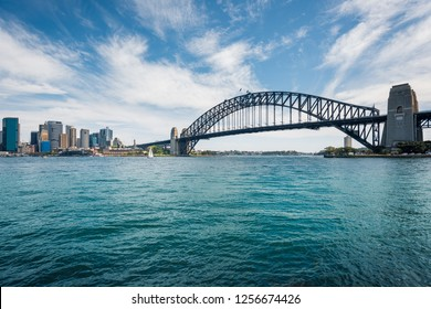 View of the Harbour Bridge and Sydney Central Business District from across the bay at Kirribilli on a beautiful sunny day.
