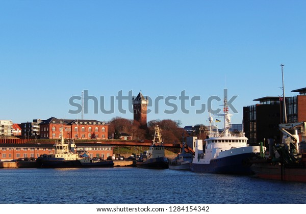 View to the harbour of Esbjerg, historical water tower in the background, Jutland, Denmark
