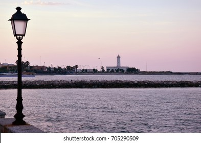 View of the harbour and Lighthouse in the background in San Cataldo a small town near Lecce, Italy