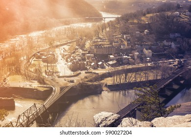 VIEW OF HARPERS FERRY NATIONAL HISTORICAL PARK, WEST VIRGINIA, USA WITH EVENING LIGHT AND FOG OVER THE RIVER IN VINTAGE TONE