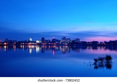 A view of the Harrisburg, Pennsylvania cityscape and state capitol overlooking the Susquehanna River at sunrise.