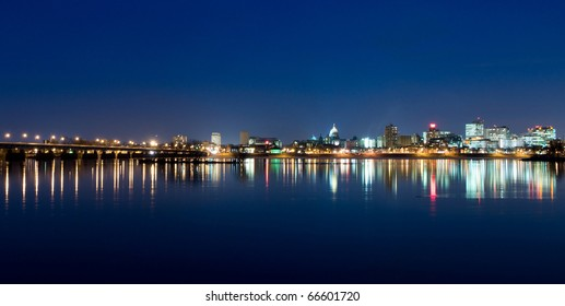 A view of Harrisburg, Pennsylvania's cityscape, state capital, and M. Harvey Taylor Bridge overlooking the Susquehanna River at night.