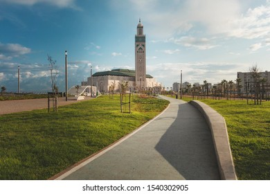 view of Hassan II Mosque from the alley in a bright day - Casablanca, Morocco