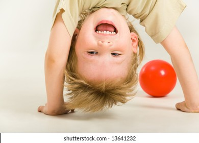 View of boy's head over heels on a white background