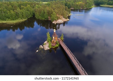 View from the height of the church of the Apostle Andrew the First-Called on the Vuoksa River in the morning of June (aerial photography). Leningrad Region, Russia