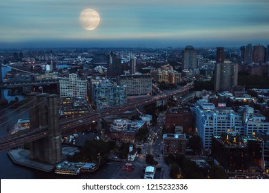 View from the heights of the night city. A huge full moon over the city on the evening city of New York.