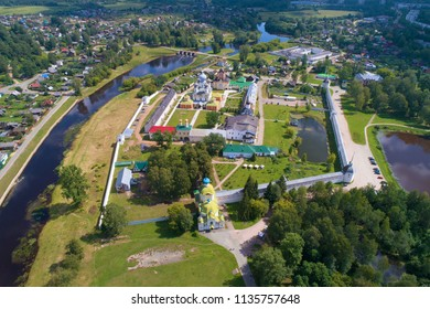 View from the heights to the Tikhvinsky Bogorodichny Uspensky Monastery on a sunny July afternoon (aerial photography). Tikhvin, Russia