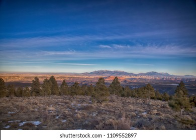 View of the Henry mountains and Capital Reef from the Boulder mountains in January 2018 Utah.