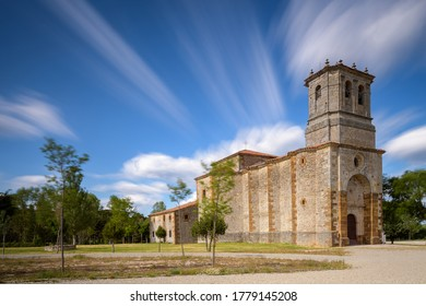View of the hermitage of La Blanca under a blue sky with moving clouds, near the population of Cabrejas del Pinar, in the province of Soria. Spain