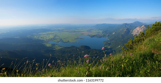 view from herzogstand mountain to alpine foothills and lake kochelsee, upper bavaria