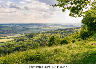 View from the Hesselberg on the franconian landscape with villages and fields in the light of the evening. Clouds are hanging in the sky. The Hesselberg is a hill in Middle Franconia/Bavaria/Germany.