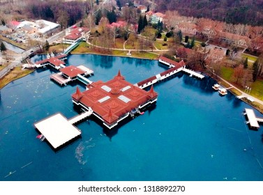 view of Heviz thermal in Hungary. Wellness center in the middle of the lake. Hot water is coming out from the source.