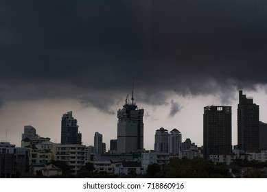 View of high buildings and towers in Bangkok, Thailand under storm sky.
