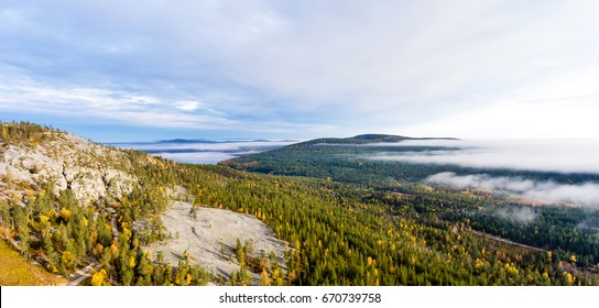 View from a high hill top over autumn forest in Finnish Lapland