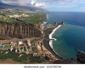 """View from a high mountain down to """"Puerto de Tazacorte"""" a tourist small resort on La Palma. the largest Barranco of the island ends there by the sea with very high cliffs."""