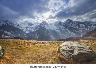View of the high mountains with rocks on the foreground - Austria