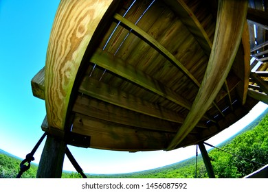 A view from a high tower at Lapham Park using a fisheye lens to create a rounded horizon line while distorting the closer structure of the frame for an unusual summer scene.