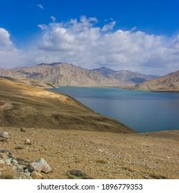 View of high-altitude Yashilkul lake in the Pamir mountains of Gorno-Badakshan in Tajikistan