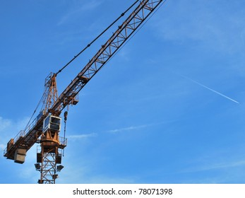 View of a high-rise construction crane on sky
