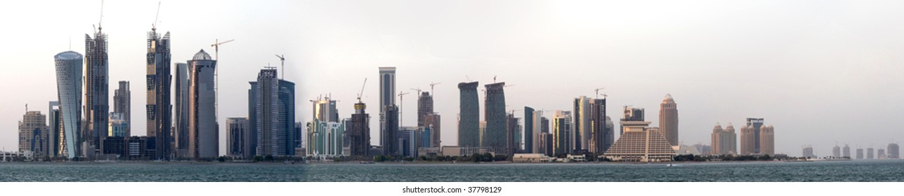 A view of the high-rise district of Doha, Qatar, still under construction (there are more than 40 cranes in this photo) on the evening of September 26, 2009. The image is a stitched panorama