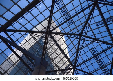 View of high-rise from ground level through glass ceiling