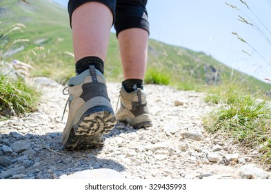 View of hiker legs walking on a path