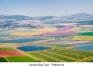A view from hill to Beit Shean Valley near the Nir David kibbutz, Israel, at spring season when agricultural areas and water ponds has a most scenic look.
