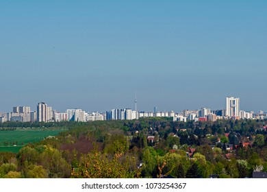 """View from a hill in Berlin over a residential area and the skyscrapers of the """"Gropiusstadt"""" in the direction of the """"Fernsehturm"""" (television tower) in Berlin-Mitte"""
