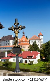 View from the hill with  crucifix (inscription in Czech- with Christ the world will be saved) on renaissance style castle, 16th century, with Roundel pavilion near river Nezarka, Jindrichuv Hradec