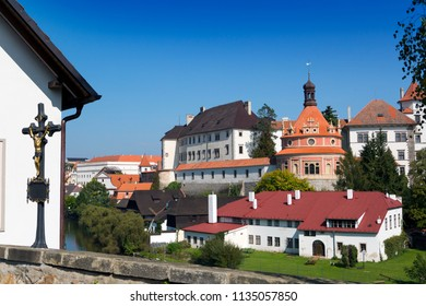 View from the hill with a crucifix (inscription in Czech- with Christ the world will be saved) on renaissance style castle, 16th century in Jindrichuv Hradec. Czech Republic