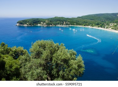 View from hill on boats on blue waters of Valtos bay and beach, Parga, Greece