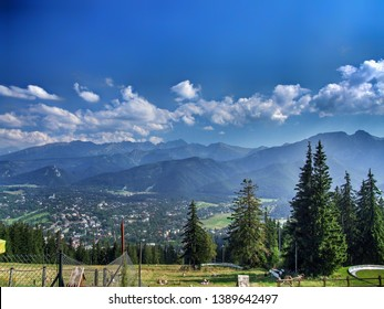 View from Gubałówka hill in Zakopane in Poland. Panorama of the city of Zakopane in Lesser Poland. Giewont and other Tatra mountain range peaks. Entartainment inf