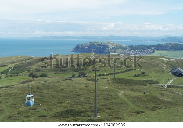 View of hilly seascape with cable way