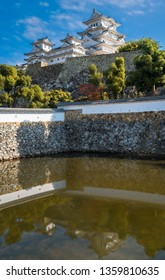 View of Himeji Castle in autumn against the blue  sky and reflected in Mikuni pond, located in Kansai area, Hyogo Prefecture, Japan. Himeji is the most beautiful example of medieval Japanese architect