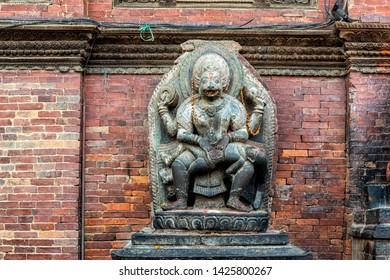 View at Hindu shrine statue during Dashain holiday, Patan Durbar Square, Kathmandu valley, Nepal