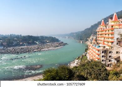 View of hinduist temple Shri Makar Vahani Ganga Jee and Sita Ram Dham Ashram on the riverbank of Ganga in Rishikesh
