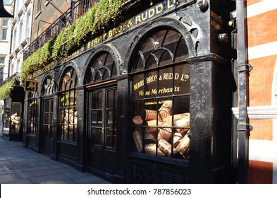 View to a historic alley with the shop window of Berry Bros. & Rudd with oversized wine corks - London, Great Britain - 08/02/2015